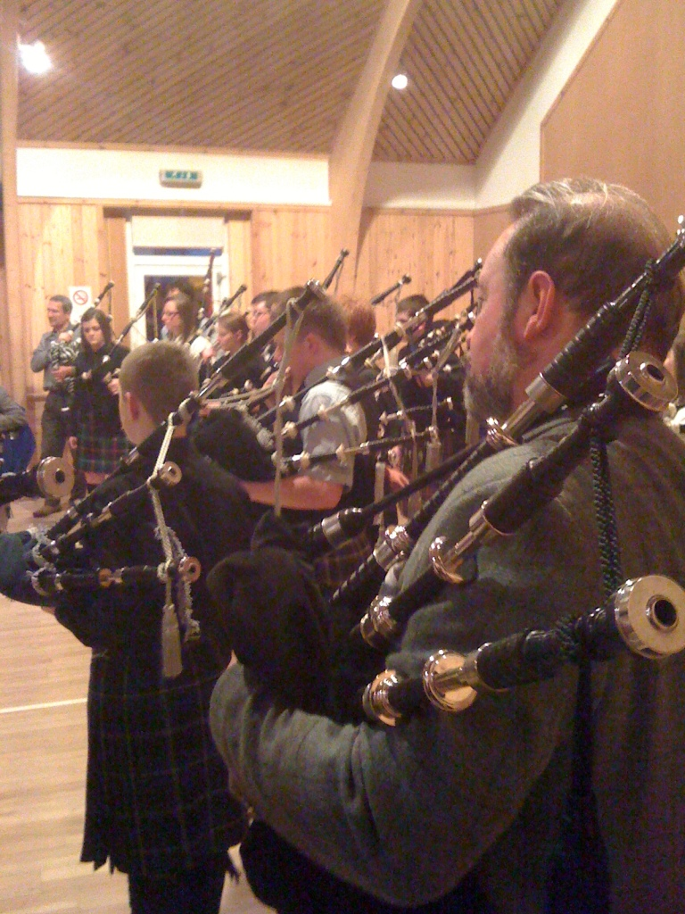 The skirl of the pipes in the community hall.