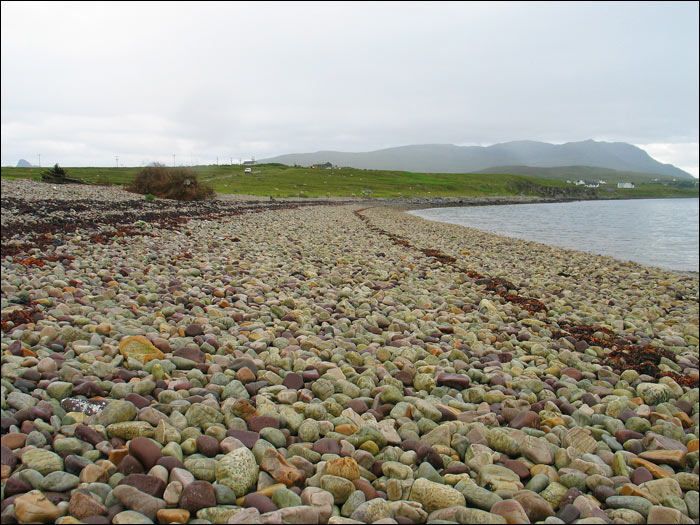 Badentarbet beach, its white quartz fossil-rich stones evidence of the 350 million-year-old geological upheaval, the Coigach Fault