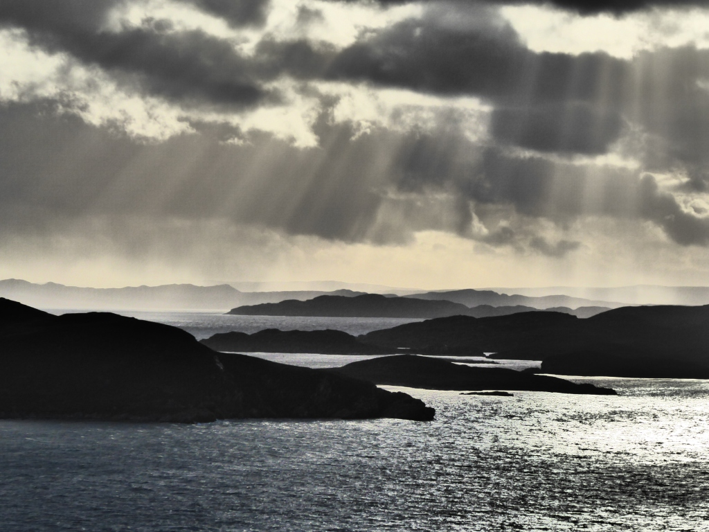 Sun pouring down onto the Summer Isles, taken from Polbain
